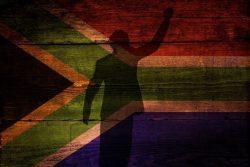 Ombre chinoise de Nelson Mandela sur fond du drapeau de l'Afrique du Sud